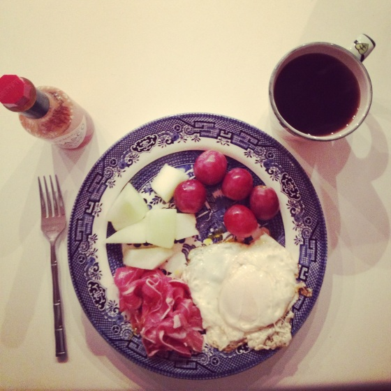 red grapes (enormous things), honeydew melon, two eggs, prosciutto, black coffee