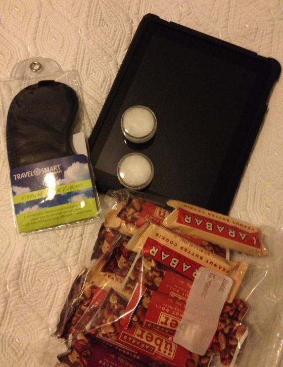Eye mask, iPad, Coconut Oil, and Larabars